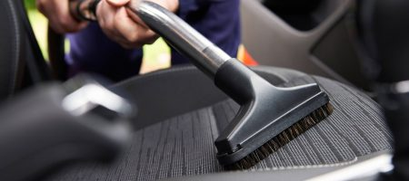 Man Hoovering Seat Of Car During Car Cleaning; Shutterstock ID 290850902; PO: today.com mish